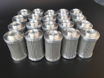 Many pieces of stainless steel pleated filter.
