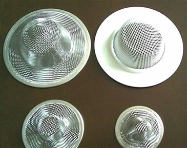 Four stainless steel cap filter with different sizes.