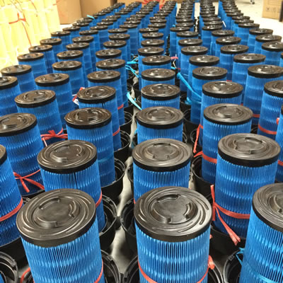 Many pieces of round blue diesel oil filter.