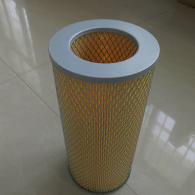 A dust collector filter cartridge with metal edge is on the floor.
