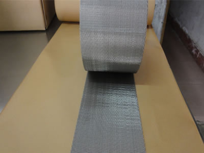 A roll of high density silver white filter belt.