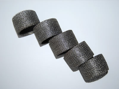 Five pieces of round compressed knitted wire mesh filter.