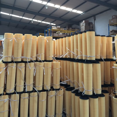 Many pieces of round orange color diesel oil filter.
