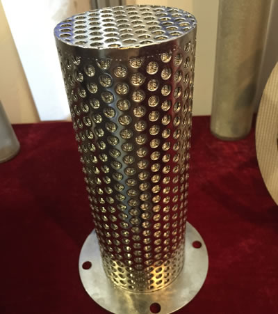 A perforated round cylinder with flat flange.