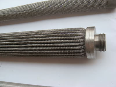 A pleated candle filter with male flange.