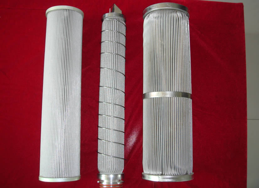 Three pieces of pleated hydraulic filter elements with different edges.