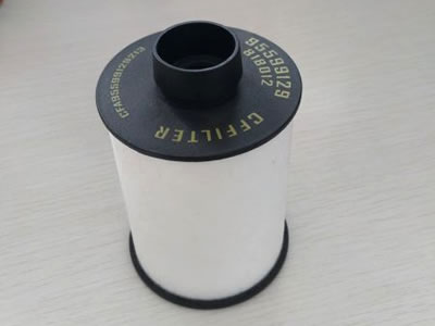 A white gas and diesel filter with raised rubber end.