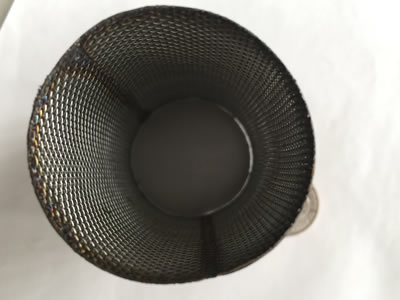 A woven wire mesh stainless steel filter cartridge.
